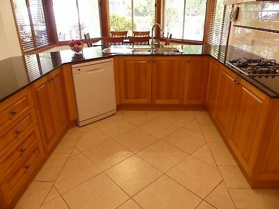 Timber kitchen comprising cupboards, stove top, sink, tap, dishwasher, microwave