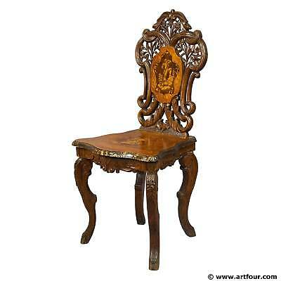 a carved and inlaid walnut chair with musical work, swiss 1900