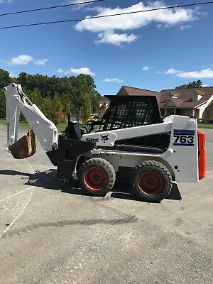 BOBCAT 763 with BACKHOE excellent condition 68' front bucket