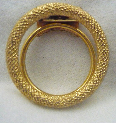 West Germany signed Tana open circle embossed gold tone metal scarf clip ring