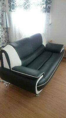 3 seater black and white sofa faux leather.