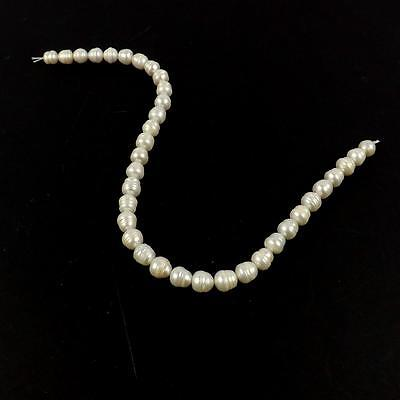 FP22.  WGGP46 White Freshwater Cultured Pearl Irregular Shaped From Approx 10x9