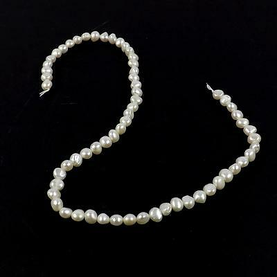 FP23.  DGGP63 White Freshwater Cultured Pearl Side Drilled Baroque Beads