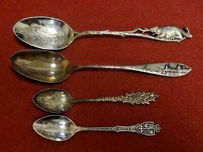 Lot of 4 Sterling Silver Souvenir Spoons.