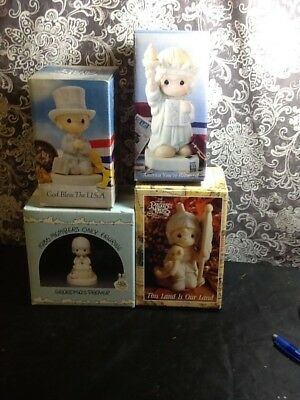 Lot of 4 Precious Moments Figurines -
