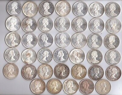 Canadian Silver Dollars - 40 - 80% Silver Dollars 1958, 62, 63,65 and 66.