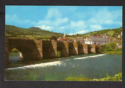 """THE BRIDGE AND RIVER USK,CRICKHOWELL  ABERGAVENNY"" Postcard Monmouthshire Wales"