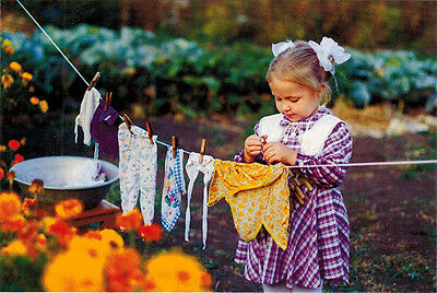 Little girl takes care about laundry Modern Russian postcard