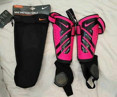 Nike shin guards with strap lock   GIRL SIZE L neon pink