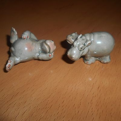 2 small pottery hippo ornaments