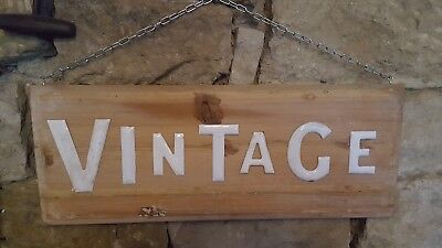 Old vintage 1950s enamel on copper letters VINTAGE mounted on an old piece wood