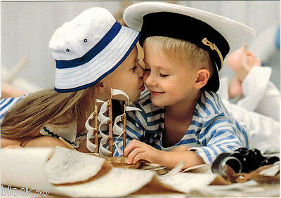 Very young sailor gets his FIRST KISS from girl Modern Russian postcard