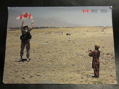 Canadian Soldier Helping an Afghan Boy Fly a Kite