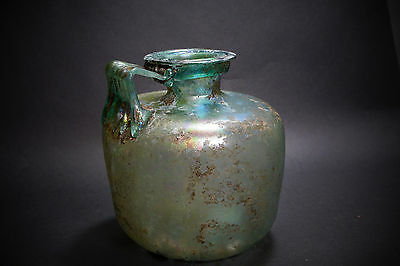 *Aphrodite Gallery* A Single Handled Roman Glass Flask, 3rd-4th Century A.D.