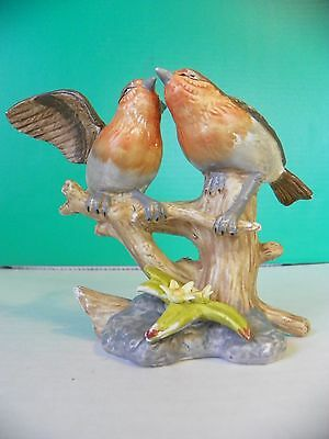 Stoneware figurine of two Robins sitting on a branch