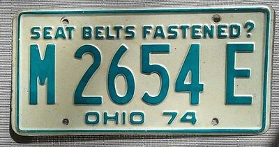 """1974 Ohio Licence Plate all embossed """"Seat Belts Fastened"""" tag number M2654E"""