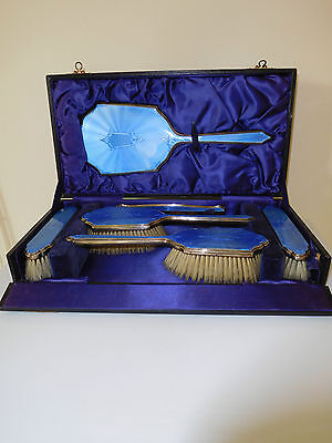 Art Deco Cased Set Silver Gilt And Blue Enamel Brush Set With Adams Decoration