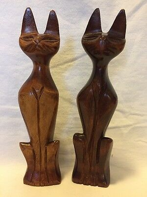 pair of hand carved wooden cats sitting figurines