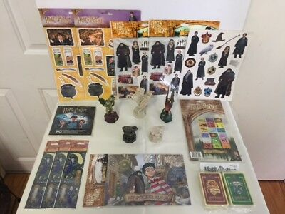 5 Harry Potter chess pieces plus stickers and sticker book and cards for a game.