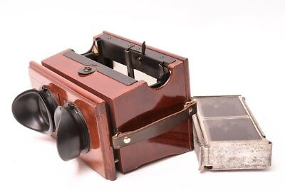 Apescope by PLANOX. Stereo viewer has an automatic loading and changing magazine