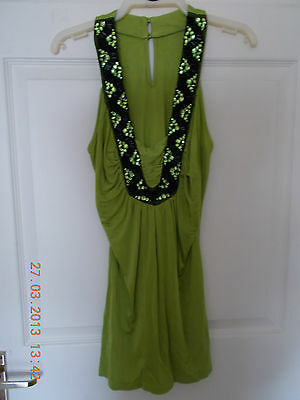 Sexy Lime Green Top With Black Sequin Gem detail around the front.