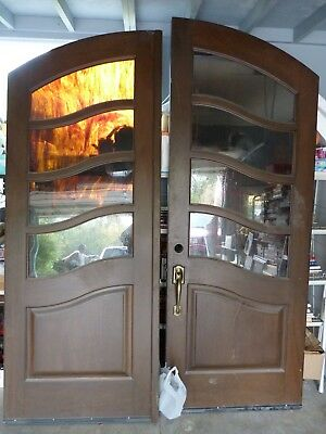 Large Exterior Arched Wood Doors with Arched Jam and Trim