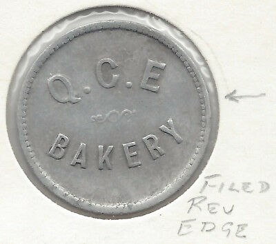 Q. C. E Bakery Good For One Loaf Round Bread Token Nicked Reverse Edge @ 9.00 o'