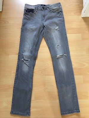 jeans garcon taille xs ou 14 ans coupe slim fit effet used