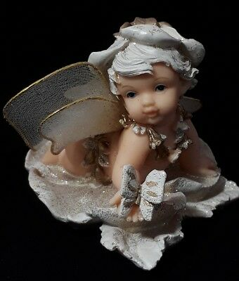 Vintage Collectible Sweet Decorative Angel Cherub Figurine Holding a Butterfly