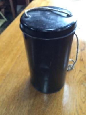 WWII original gas mask in securing tin to hang around the neck