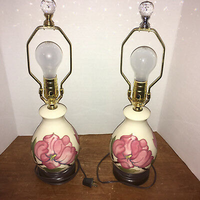 Moorcroft Pair of Magnolia Lamps on a Cream backgound.