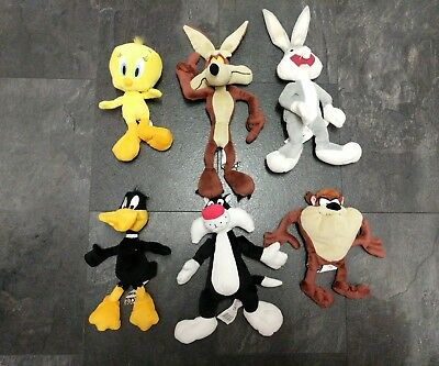 Set of 6 Boots Looney Tunes toys. Taz, buggs, Daffy, Tweety, Wylie and Sylvester