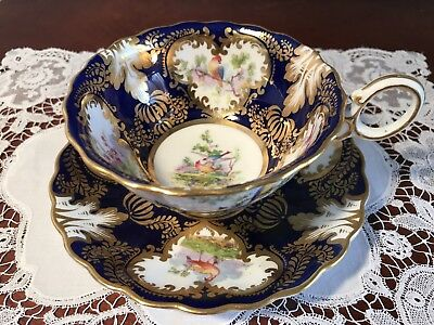 Wonderful George Jones Gilded Cup And Saucer With Exotic Birds
