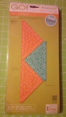 Accuquilt Quarter  square triangle 4.5 inch finished.Shape no 4  for 9 inch Cube