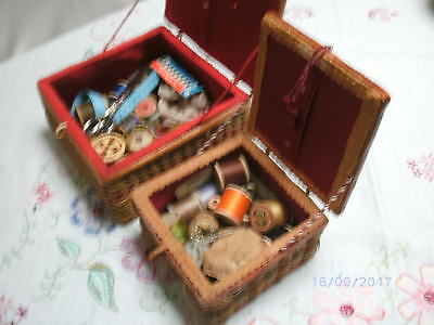 Vintage cane sewing baskets with contents
