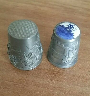 2 pewter thimbles