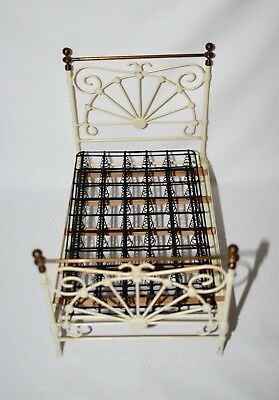 R. L. Carlisle iron and brass bed in white and brass.