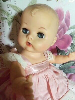 "Vogue Ginnette 8"" Squeaker Sleep Eye Baby Doll in Tagged Dress"