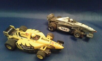 2 Tyco Hot Wheels F1 McLaren and Indy Buzzin Hornets slot cars
