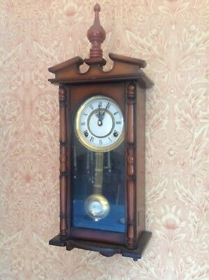 Vintage chiming-wall clock with Pendulum 8 day good condition and working well