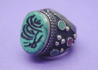 Post Medieval Islamic silver ring inlaid with stones and calligraphy insert