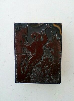 letterpress block. Man working in tree.