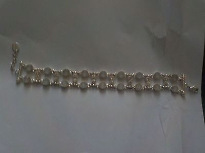 A silver bracelet with clear crystals and white stones never worn