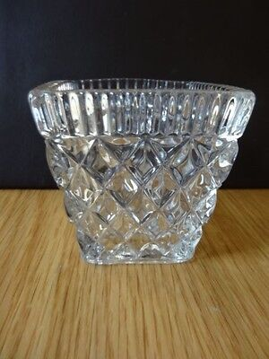 A square shaped cut glass vase