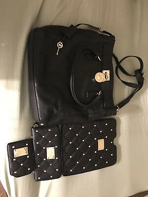 4 pc. Michael Kors Blk Handbag, tablet case, zip around wallet I.D/ CC holder.