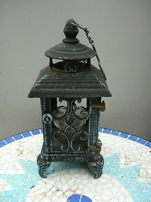 Very Heavy old cast iron lamp - takes tealights in a glass. Stand or hang