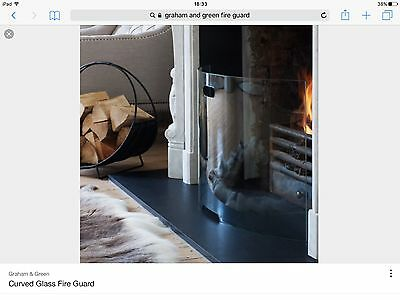 curved glass fire screen like Graham and Green