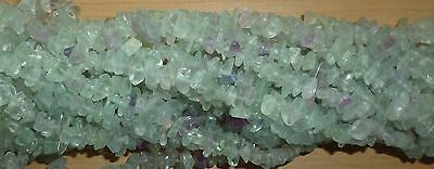 "Fluorite Drilled Chips - String approx 35"" long and weighs 70 grams mainly green"