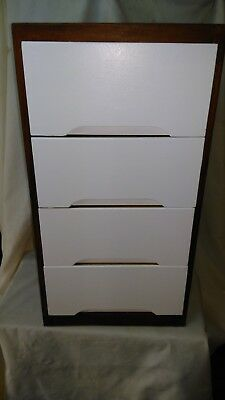 Wooden four draw cabinet white draws with polished wood carcass
