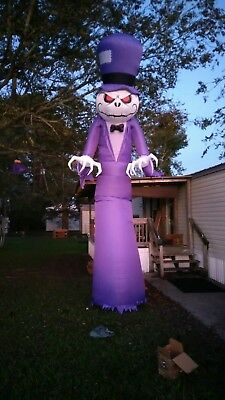 Holiday Living 16-ft x 6-ft Lighted Reaper Halloween Inflatable Model # 71952